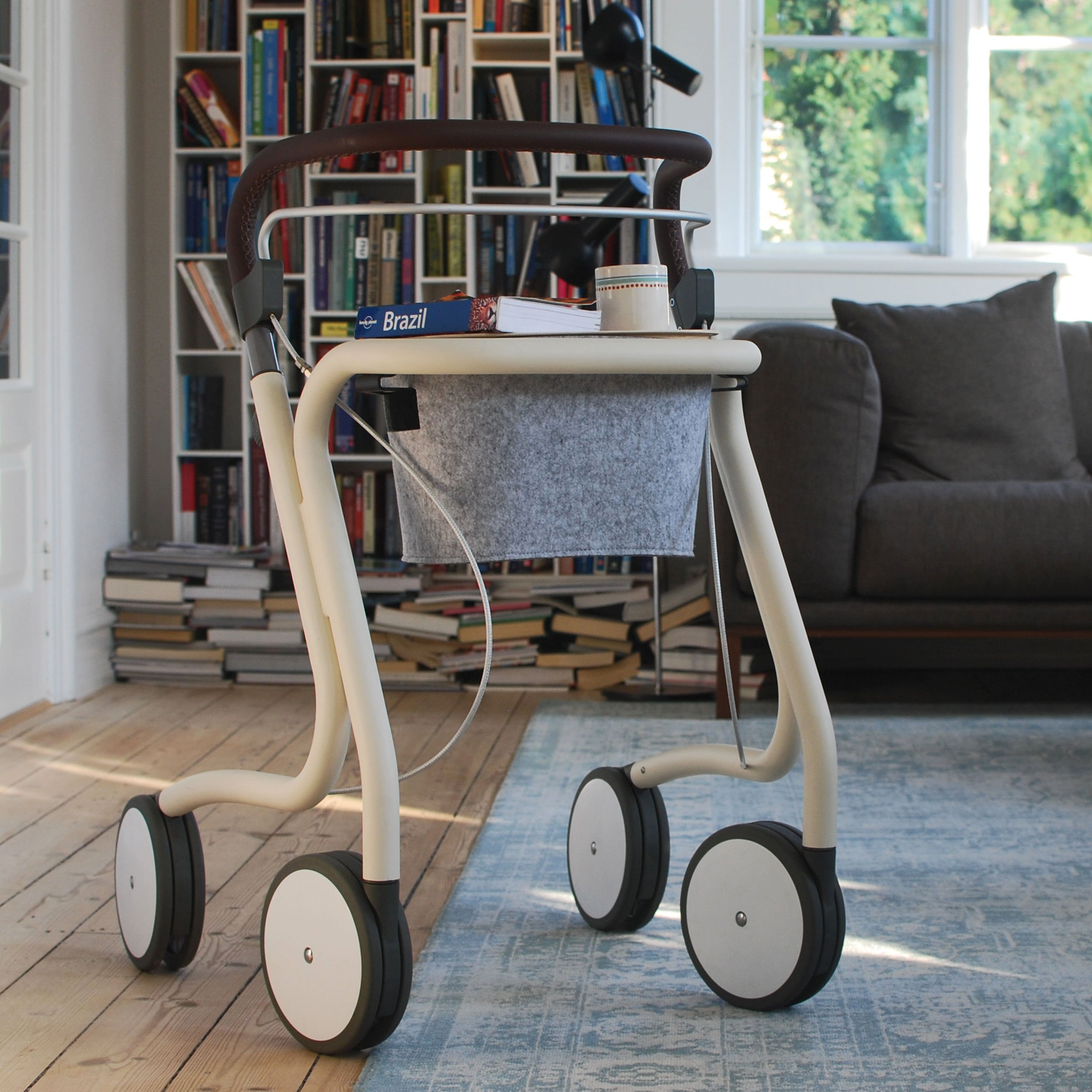 White Scandinavian Butler Rollator byACRE - seen in perspective in a living room setting