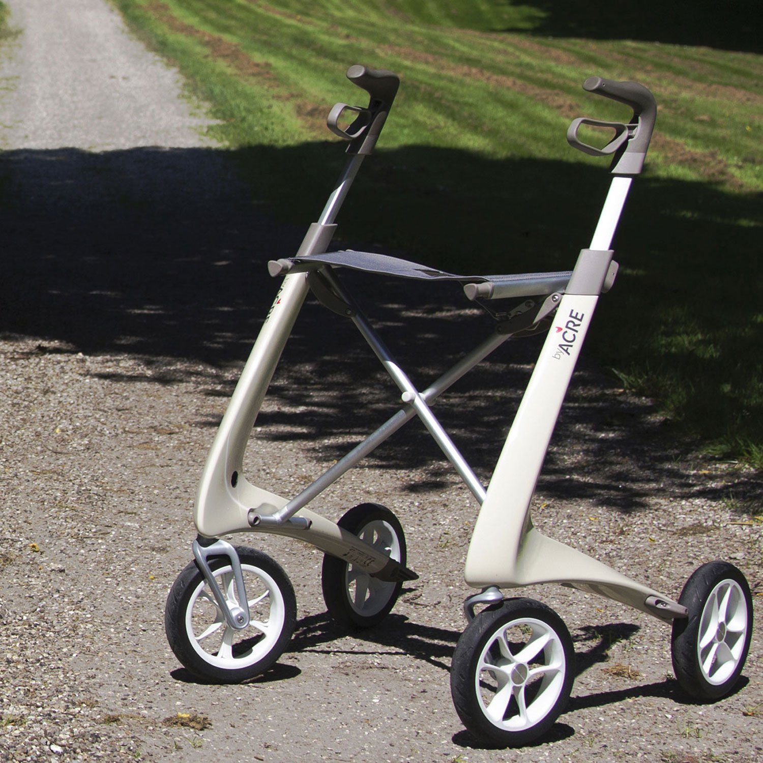 Carbon Ultralight Rollator in Oyster White byACRE - seen in perspective standing on grass