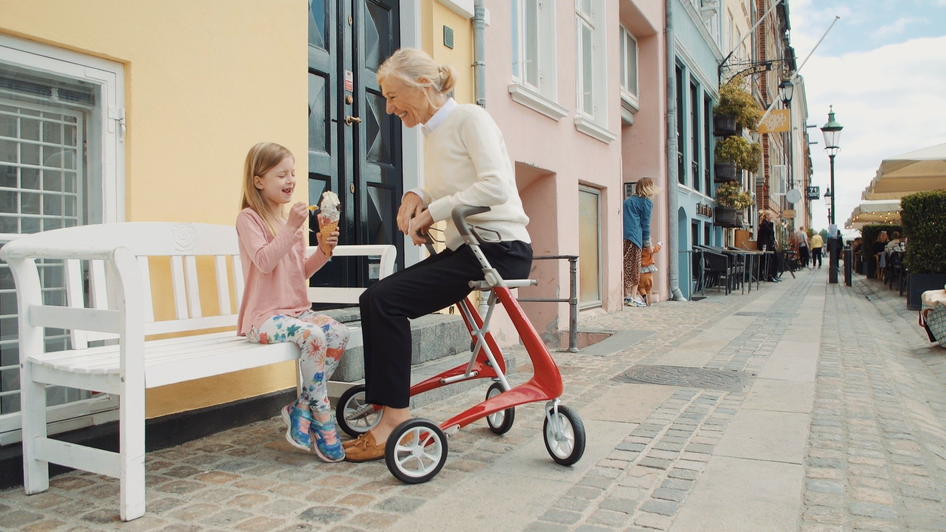 Woman sitting on Carbon Ultralight at Nyhavn in Copenhagen with her granddaughter